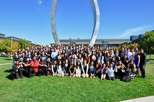 UC Merced Fraternity and Sorority group photo in front of Beginnings Statue
